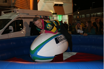 Scared looking fan riding a rodeo ball at Franklin's Gardens