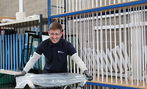 Happy technician with glass